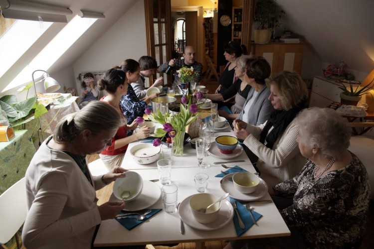 Large group of people having dinner in a small space